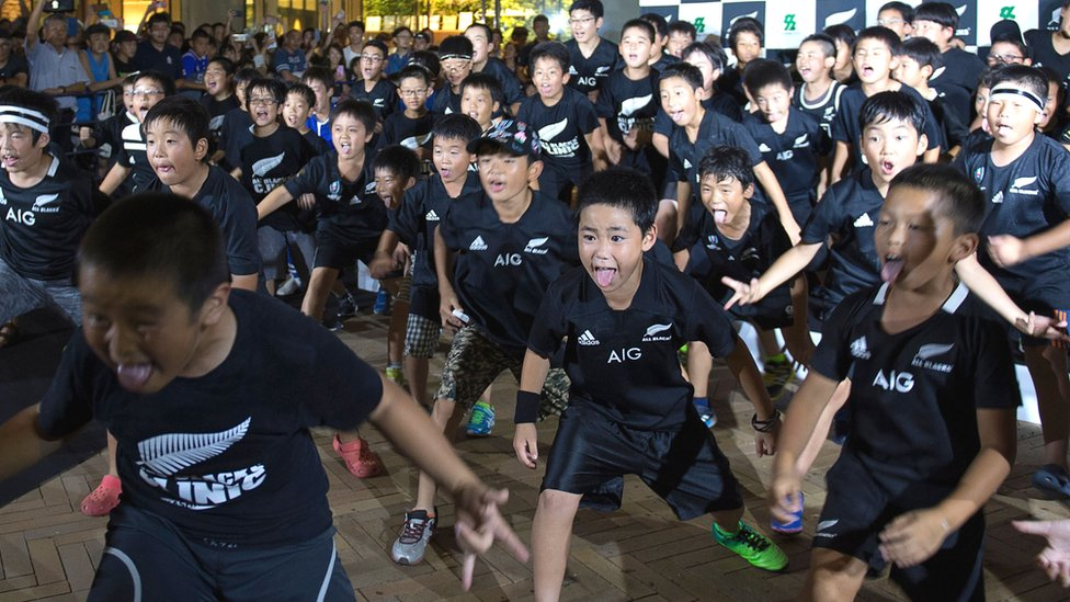 Japanese children perform the Haka during a welcome ceremony for the New Zealand All Blacks team