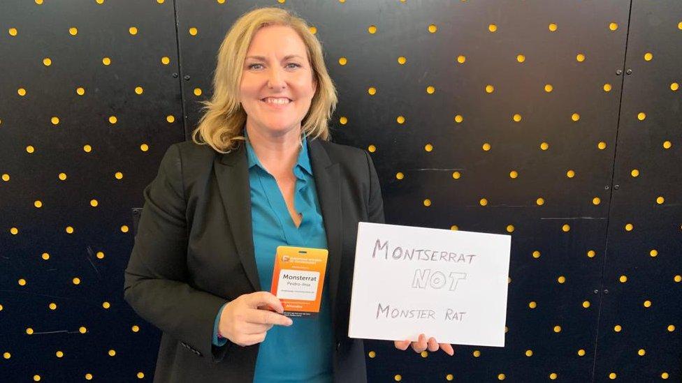 Montserrat Peidro-Insa holding up a sign saying Montserrat NOT Monster Rat