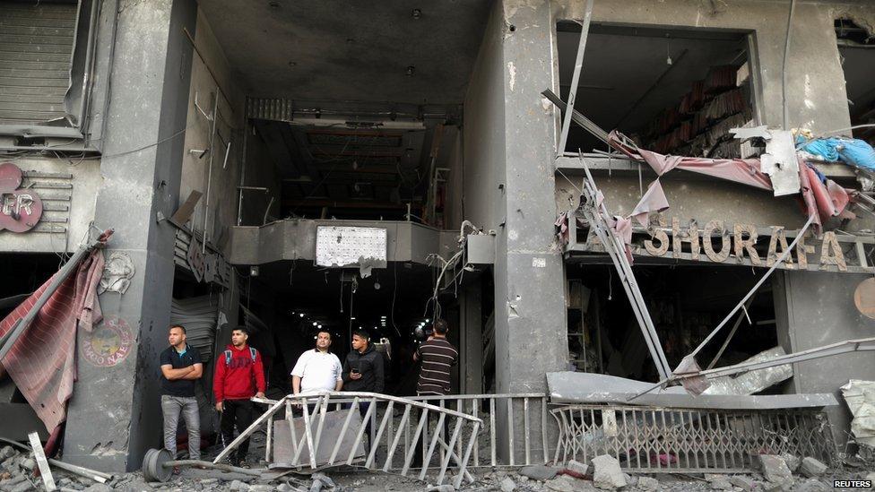 Palestinians surveying damage in May 2021
