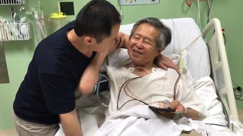 Kenji Fujimori announces the pardon to his father Alberto in hospital, 24 December