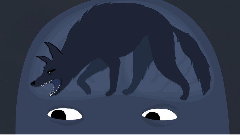 Ilustración de un lobo negro en la mente de una persona