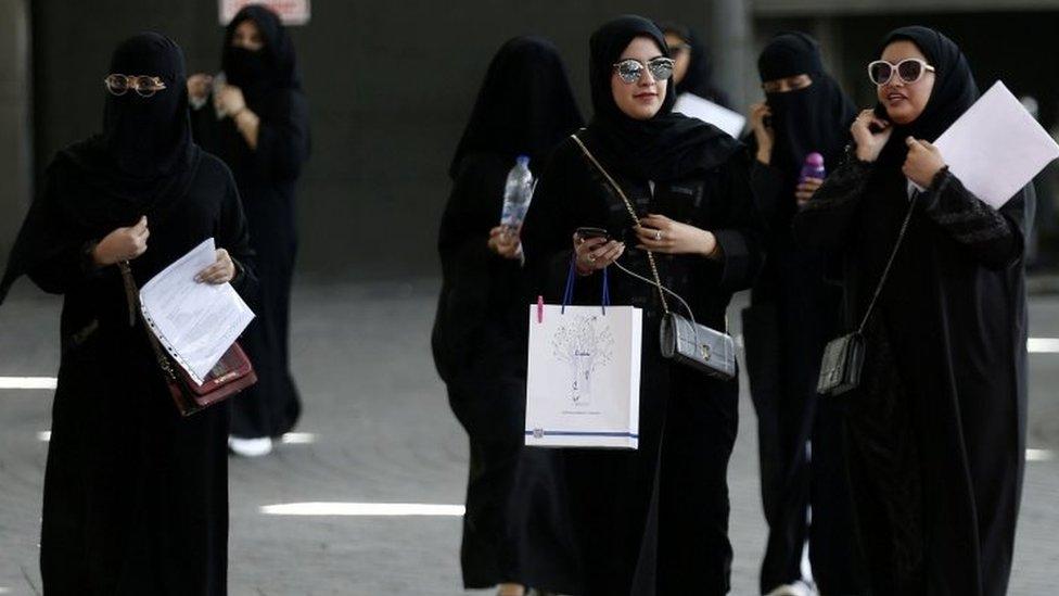 Women walk among traffic in Riyadh (file photo)