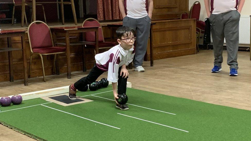 Seven-year-old short mat bowls player, Hari, from Trimsaran