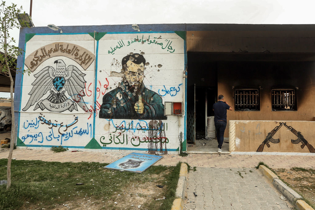 """A defaced mural of Mohsen, who served as """"minister of defence"""", at the brothers' detention centre"""