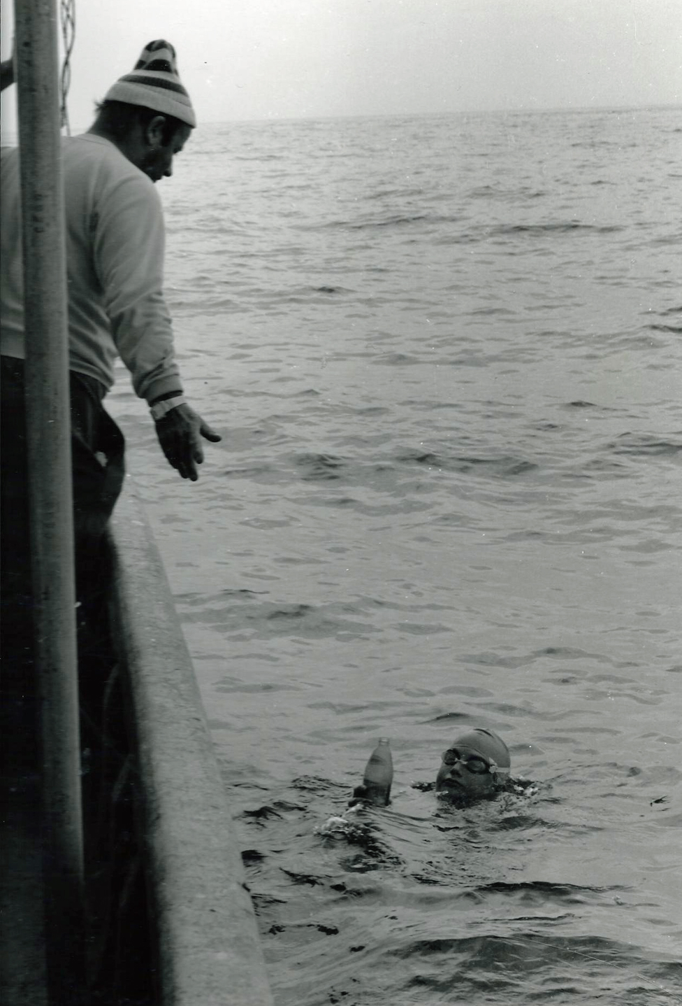 John Bullet looks down on Tom Gregory as he swims the channel