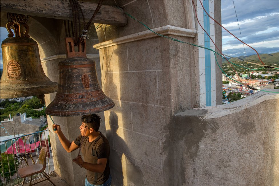 A man rings the church bells in the town of Acatlán, Puebla, Mexico, October 18, 2018