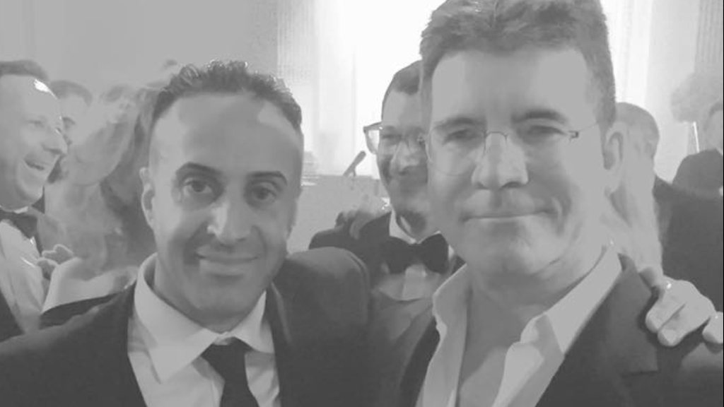 Manni Hussain grabbing a picture with Simon Cowell
