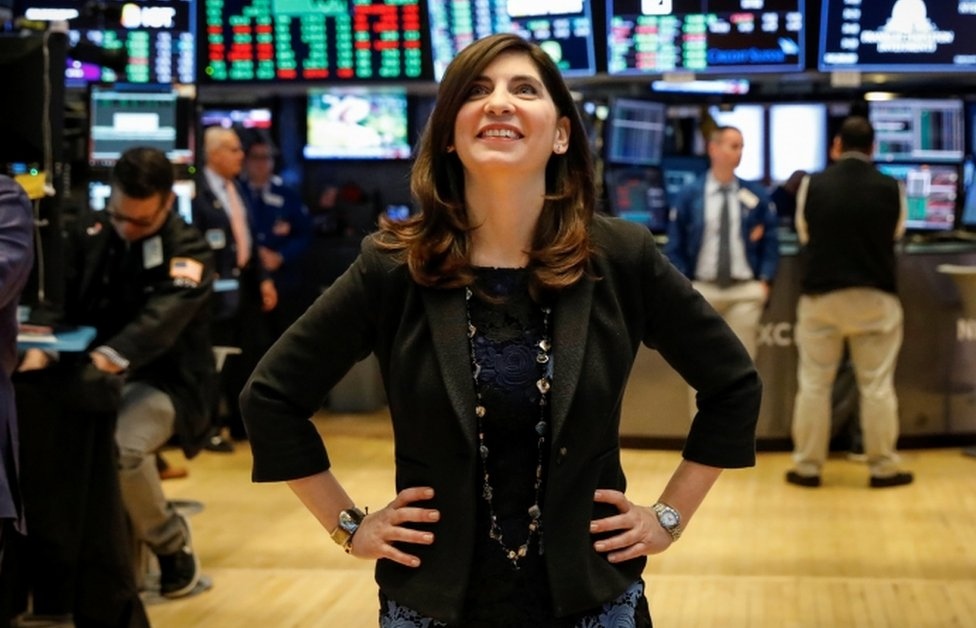 Stacey Cunningham pictured smiling on the floor of the New York Stock Exchange