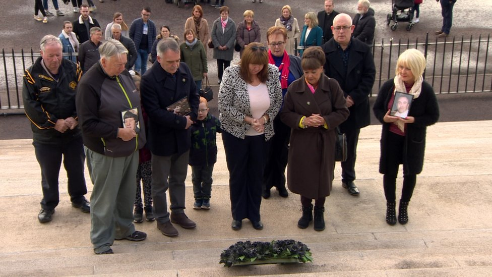 The families stood in silence after laying the wreath at Stormont