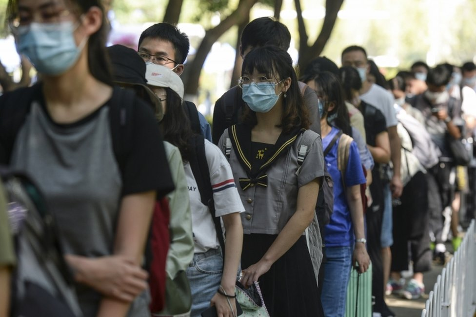 Students returning to study at university in Wuhan