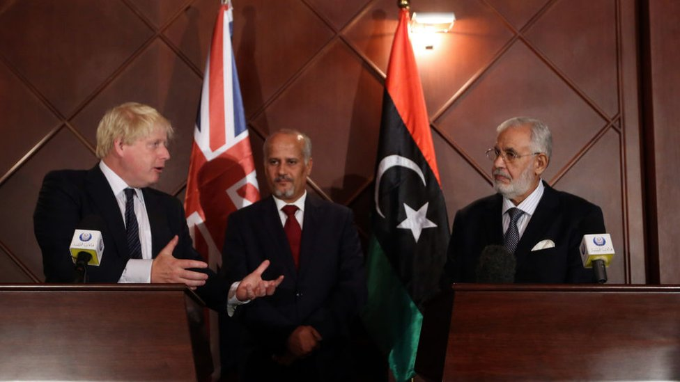 Boris Johnson (L) speaks during a press conference with Mohamed al-Taher Siala (R), Foreign Minister of the UN-backed Libyan Government of National Accord