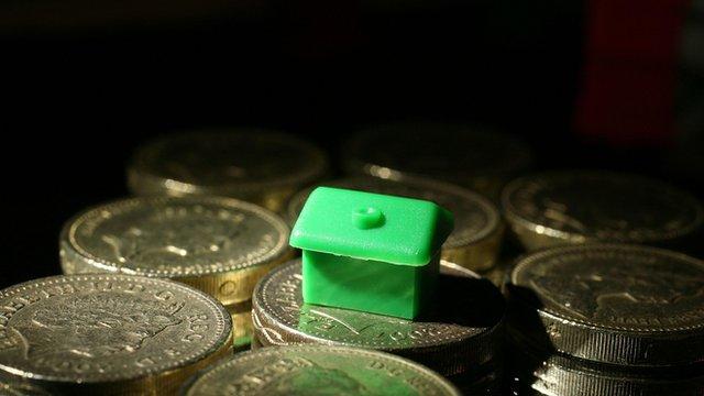Monopoly piece on cash