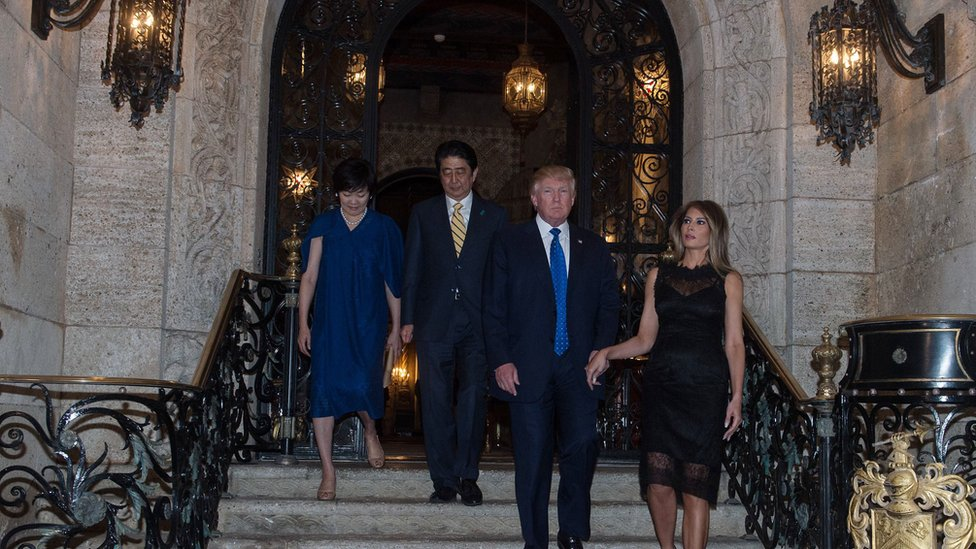 The Trumps pose for photos with Prime Minister Shinzo Abe and his wife, Akie