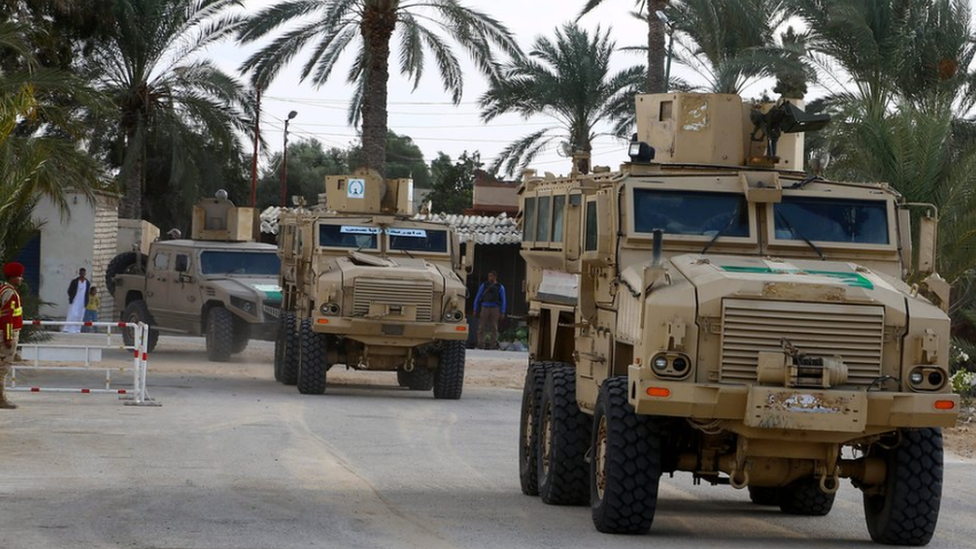 Security forces patrol near the al-Rawda mosque in the northern city of El-Arish, Sinai, Egypt (23 November 2018)