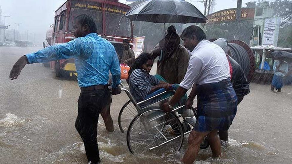Patients being shifted from a flooded hospital after heavy rains in Chennai.