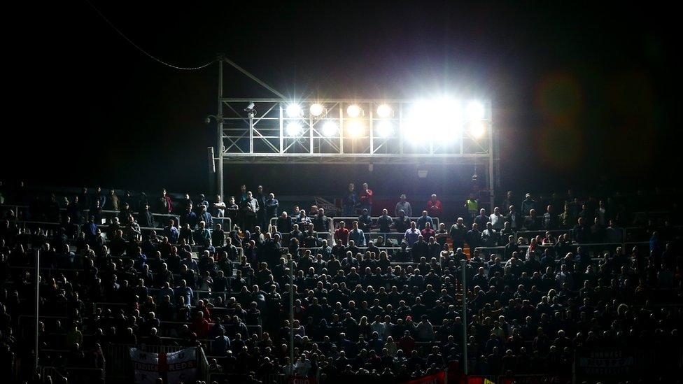 Stadium light shining over audience