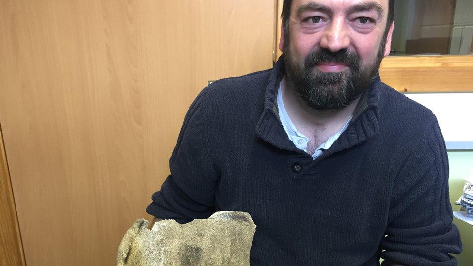 Martin Carruthers hold whale vertebra