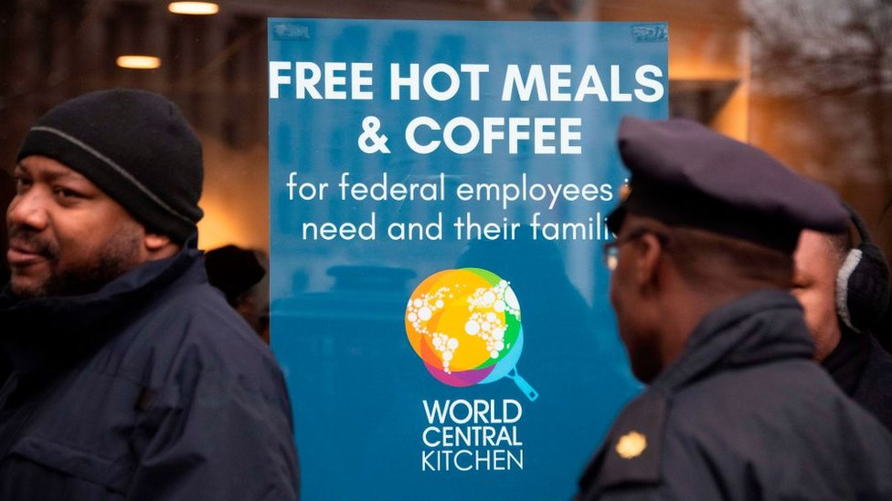 Government workers queued for free food during the shutdown