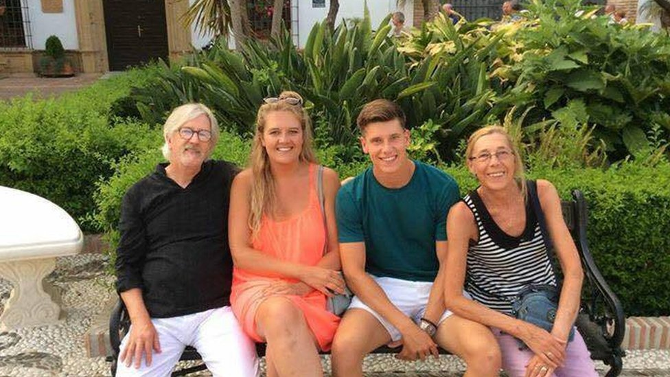 The family on a holiday before Mr Gibson fell ill