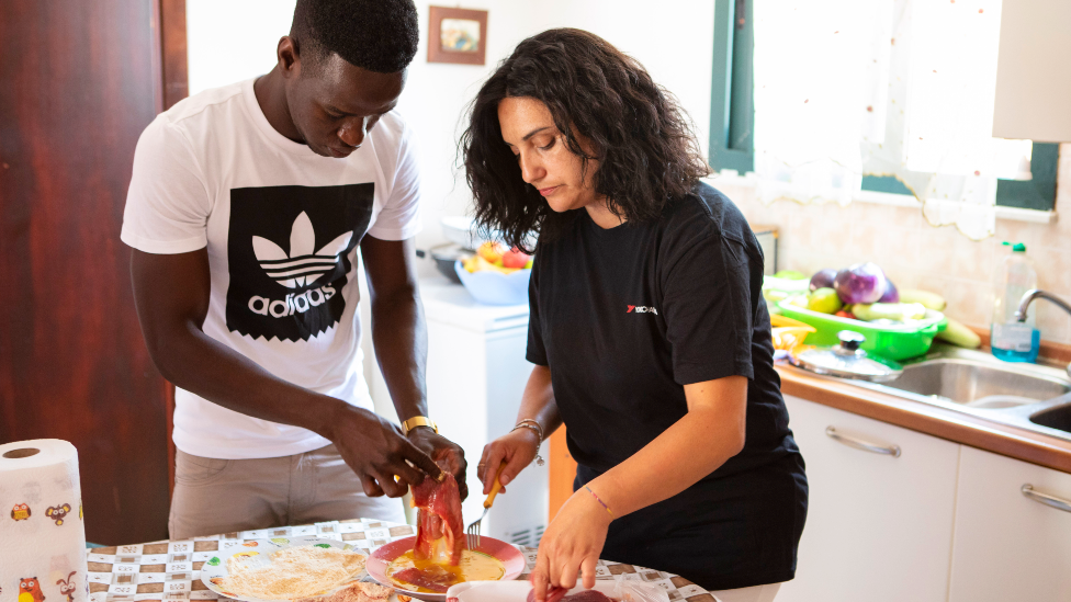 Muhammed Sanneh and Giusella Ferraro cooking