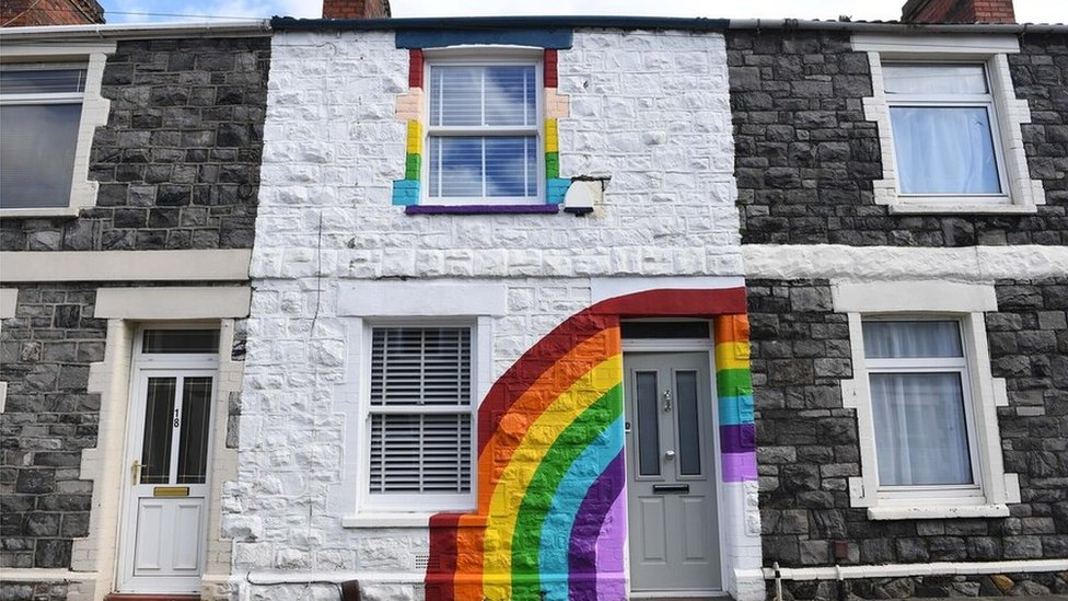 Rainbow painted on the front of a house in Splott, Cardiff