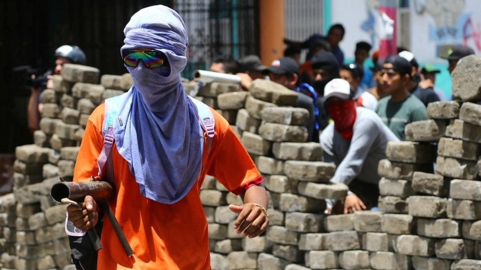 A masked demonstrator clashes with riot police during a protest against Nicaragua's President Daniel Ortega's government in Masaya, Nicaragua June 2, 2018