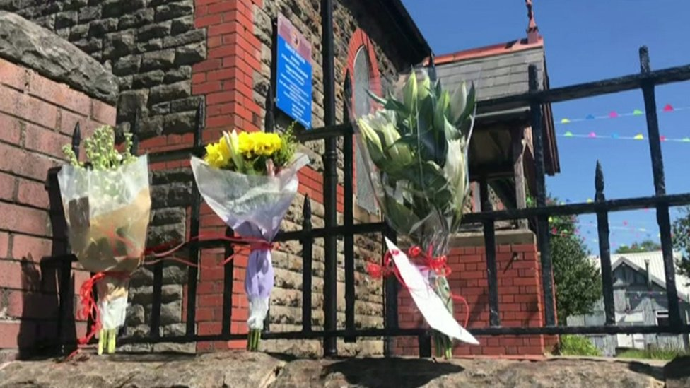 Floral tributes on church railings