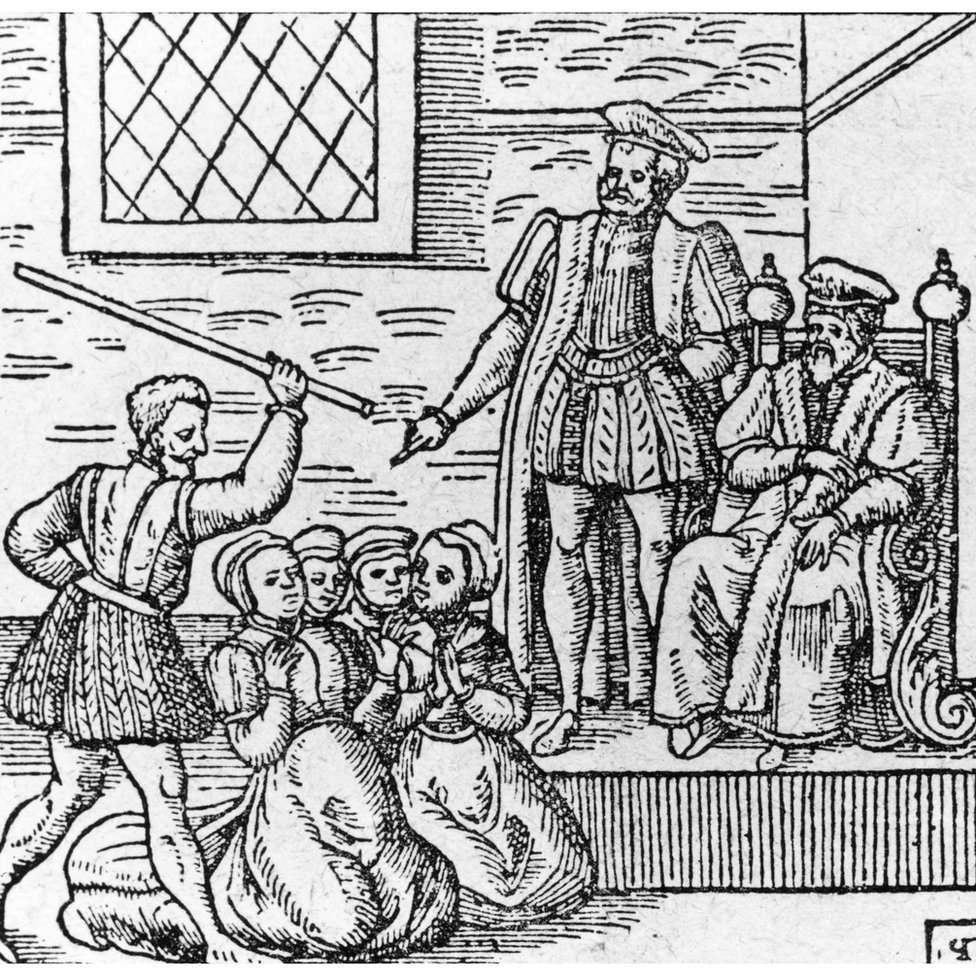A group of supposed witches being beaten in front of King James I (King James VI of Scotland)