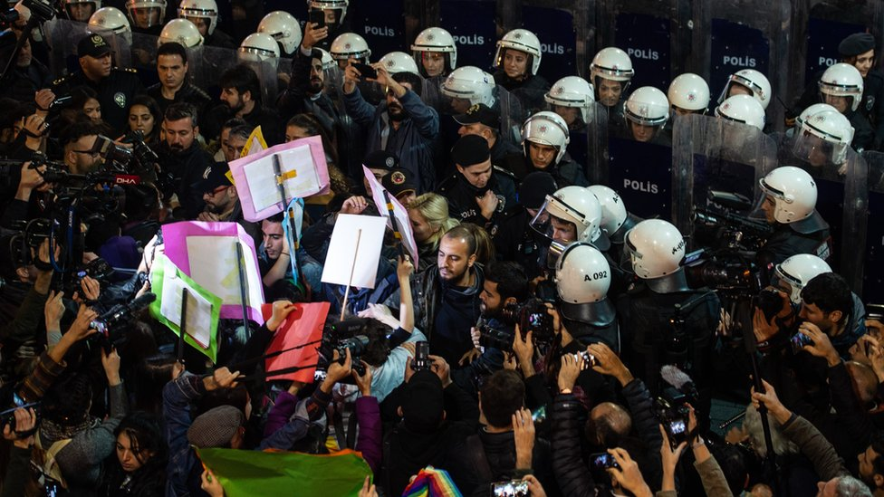 Demonstrators scuffle with riot police during a protest against femicide and violence against women on 25 November, 2019 in Istanbul, Turkey.