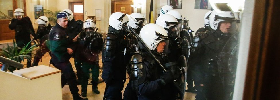 Riot police officers at the office of Justice Minister Koen Geens during a protest of prison guards on May 17