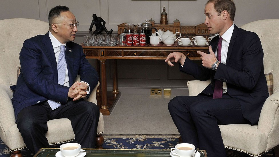 Britain's Prince William, Duke of Cambridge with Sanpower Group Chairman Yuan Yafei, at Kensington Palace Oct 2015 where the Prince, in his role as President of United For Wildlife, attended the signing of a memorandum of understanding between The Royal Foundation of The Duke and Duchess of Cambridge and Prince Harry and Sanpower, enabling United for Wildlife to create two ranger training stations in Africa