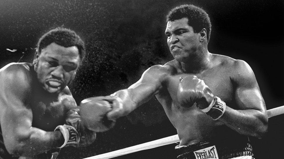 Muhammad Ali hitting Joe Frazier in 1975