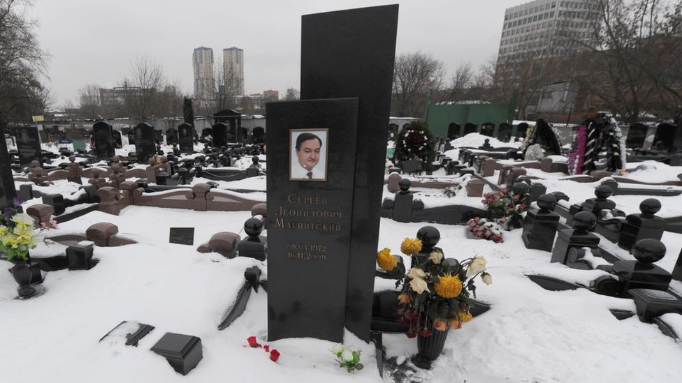 The snow clad grave of Russian lawyer Sergei Magnitsky with his portrait on the tomb in Moscow in 2012
