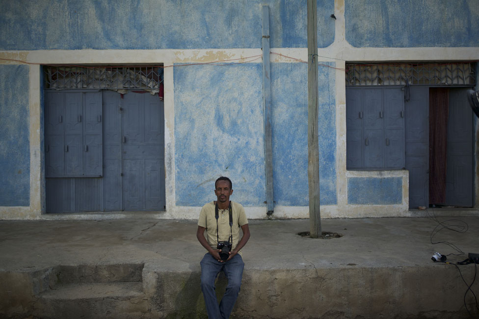 Man in front of a house