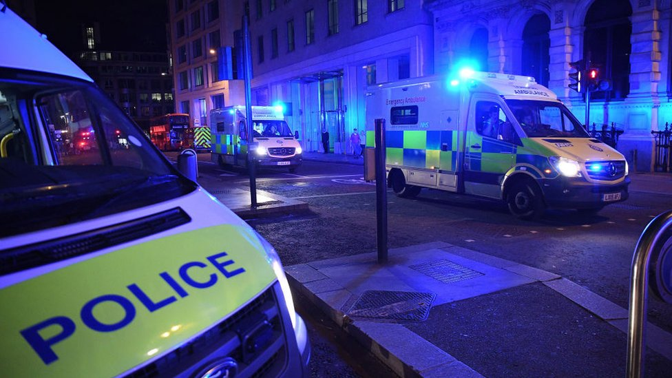 Ambulance and police vehicles respond to London Bridge attacks on 3 June 2017