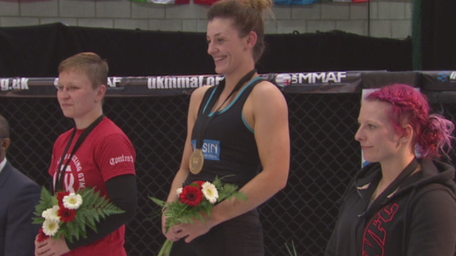 Leah McCourt receives her gold medal at the 2015 IMMAF European Open Championships of Amateur MMA