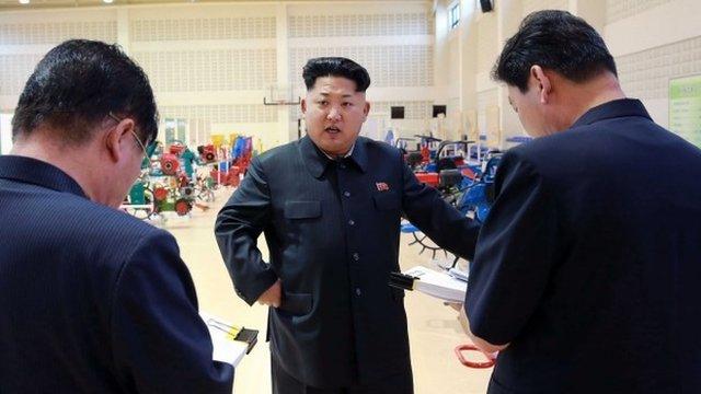 North Korean leader Kim Jong-Un visiting a farm machine exhibition