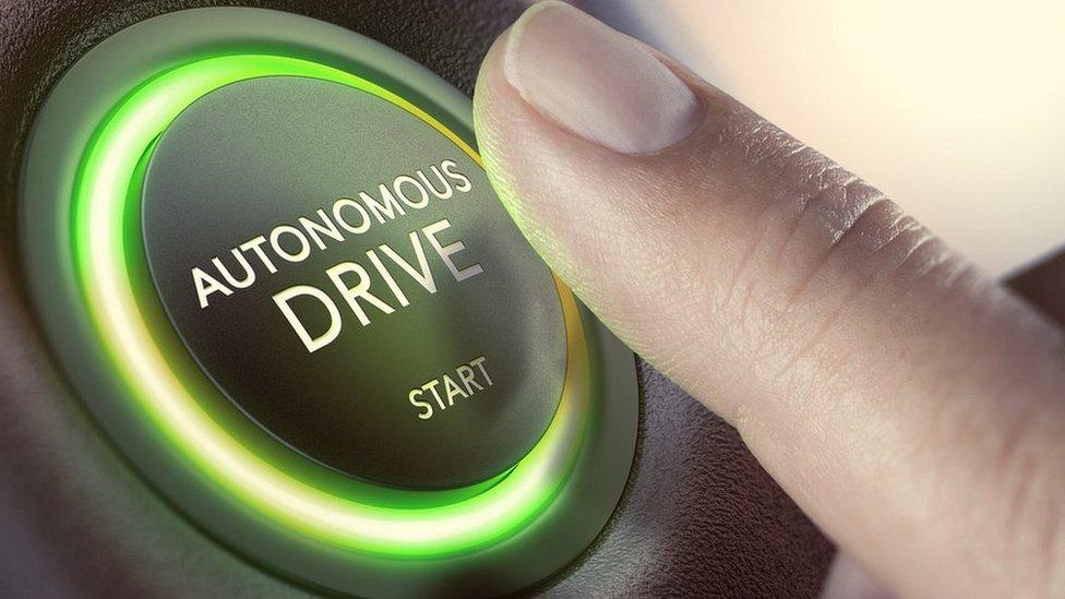 Graphic of autonomous drive button in car