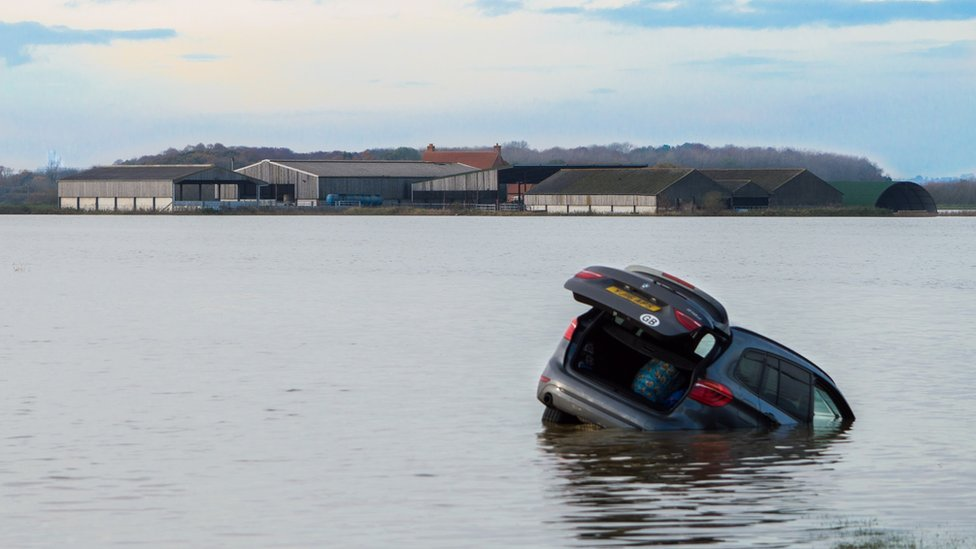 Car floating in flood water in Lincolnshire