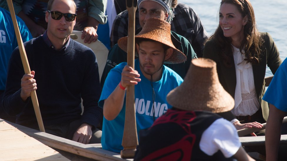 The Duke and Duchess of Cambridge, sit on a First Nations canoe after paddling to shore with members of the Haida First Nation in Haida Gwaii, British Columbia on September 30, 2016.