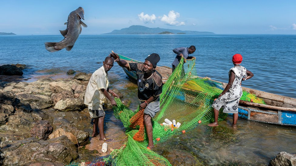 Kenyan fishermen unloading a small catch
