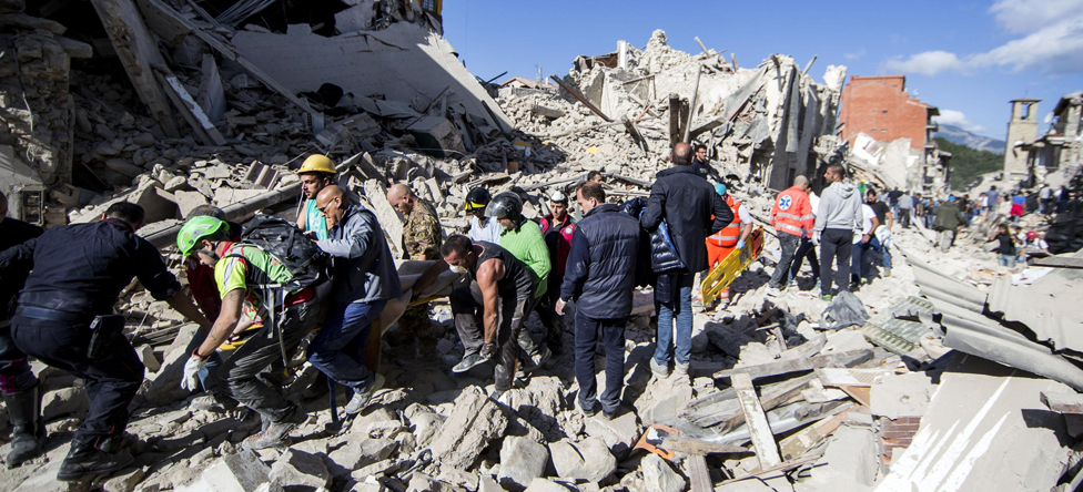 Rescuers in Amatrice, Italy on 24 August 2016