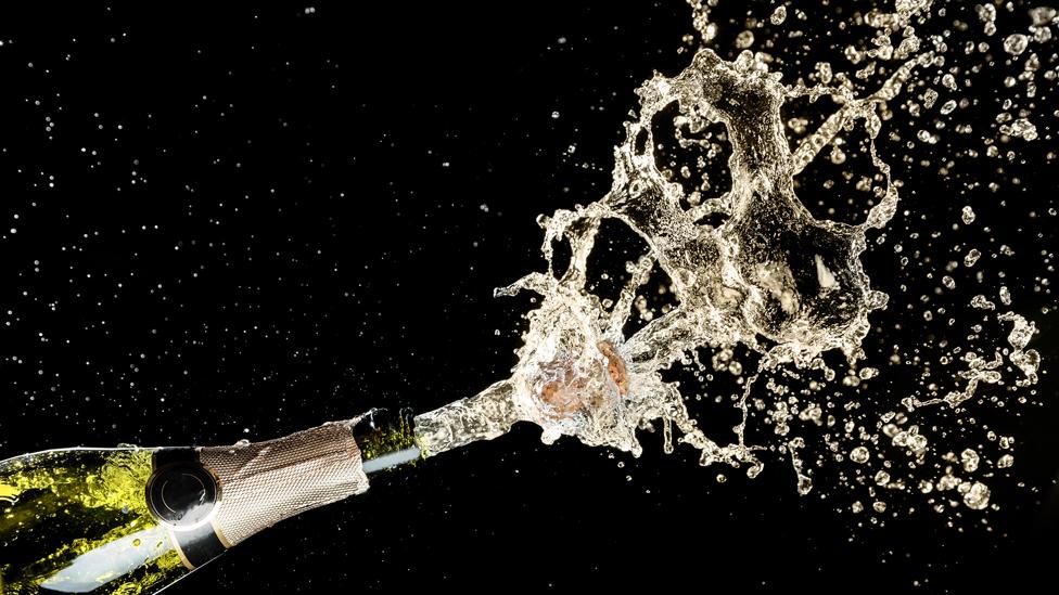 Descorche de una botella de champagne