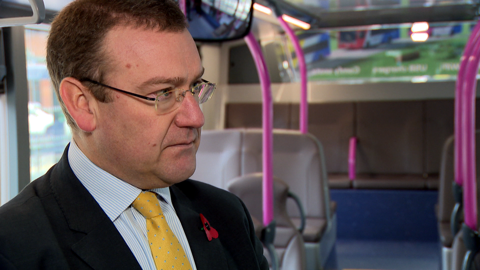 Andrew Jarvis, managing director of First Bus, being interviewed on a bus