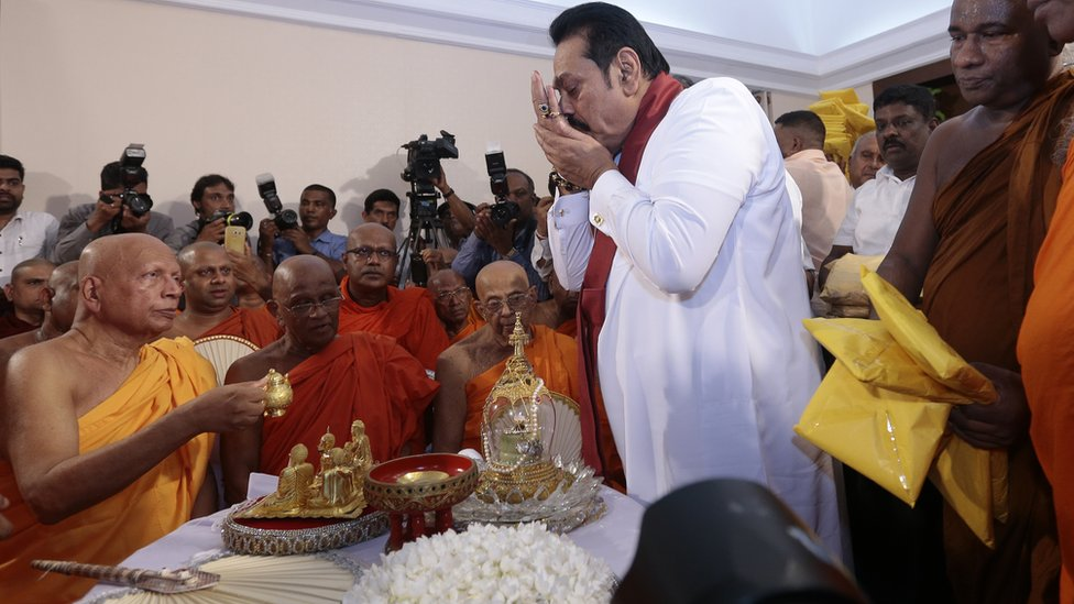 Sri Lanka's former president Mahinda Rajapaksa receives blessings from Buddhist monks before assuming duties as the new Prime Minister at the Prime Ministers office in Colombo, Sri Lanka 10-29-2018.