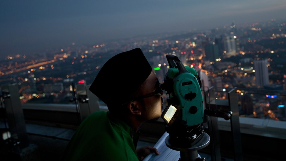 A Malaysian Islamic authority official performs the sighting of the new Moon to determine Eid al-Fitr in Kuala Lumpur, Malaysia. 16 July, 2015
