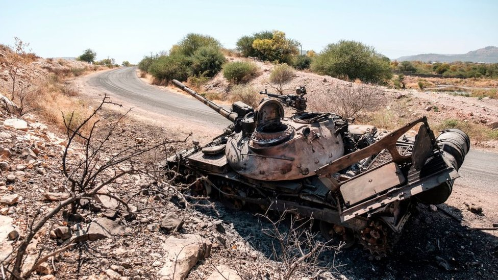 A damaged tank stands abandoned on a road near Humera, Ethiopia, on November 22, 2020.