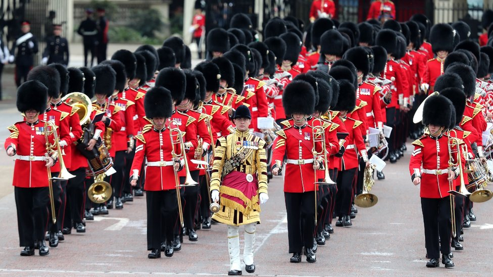 Members of the Welsh Guards, a regiment of Household Division, march to Horseguards parade during Trooping The Colour