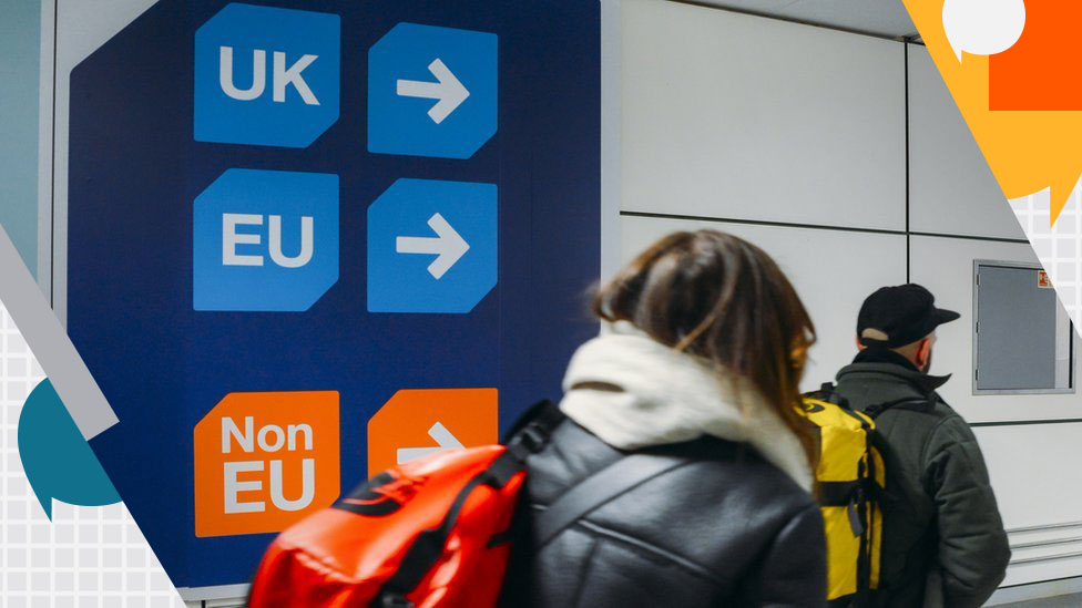 Woman carrying rucksack by UK/EU signs