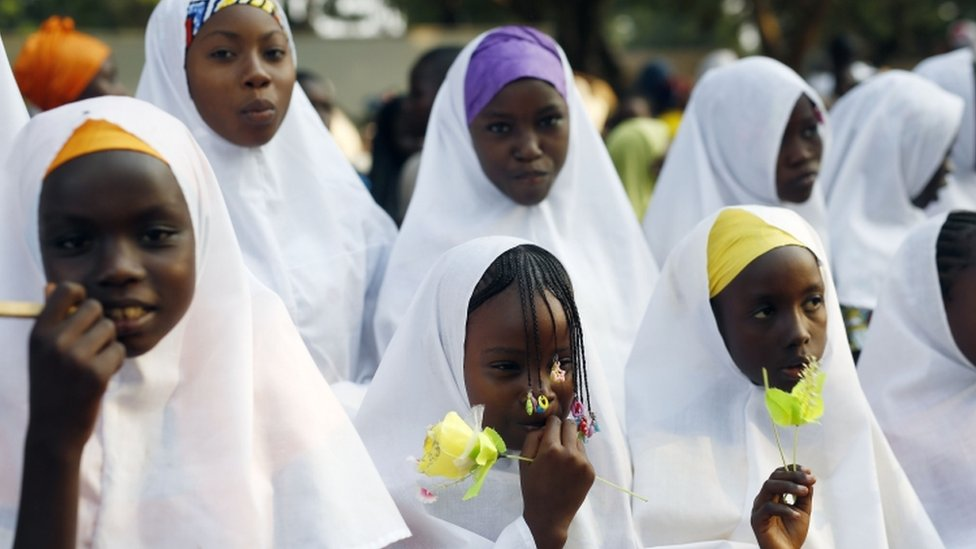"""Children wait for the arrival of Pope Francis on the occasion of his visit at the Central Mosque in Bangui""""s Muslim enclave of PK5, Central African Republic"""